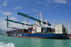 CMA CGM Jamaica Ship in Miami. This photo was taken in Miami. Miami, at Florida's southeastern tip, is a vibrant city whose Cuban influence is reflected in the Stock Images