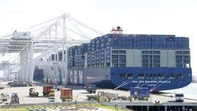 CMA CMG BENJAMIN FRANKLIN loading at the Port of Oakland. Oakland, CA - February 25, 2016: CMA CGM BENJAMIN FRANKLIN loading at the Port of Oakland. The megaship Stock Image