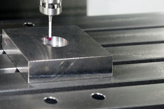 The CMM,Coordinate Measuring Machine. Inspection with the sample work piece stock image