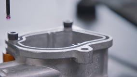 CMM measuring machine probing a high precision metal part