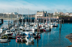 Commercial Marina in Scarborough, United Kingdom. Scarborough Marina, UK illuminated by early morning sun royalty free stock photos