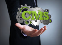 Cms coding. Businessman over hand royalty free stock photos