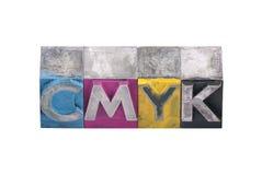 Cmyk由金属信件做了 免版税库存照片