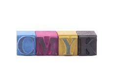 Cmyk由活版块做了 库存图片