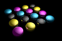 CMYK. Rendered CMYK ink drops on a black reflective background Stock Photography