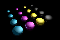 CMYK. Rendered CMYK ink drops on a black reflective background Stock Photos