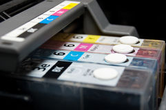 CMYK. Close-up shot of a CMYK ink cartridges for a color printer Royalty Free Stock Images