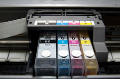 CMYK. Close-up shot of a CMYK ink cartridges for a color printer Royalty Free Stock Photo