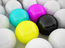 CMYK balls standing out from the others Royalty Free Stock Photos