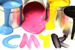 CMYK cans of paint Stock Photos