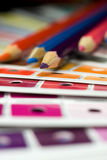 Cmyk color bars on printed. And pencils Stock Image