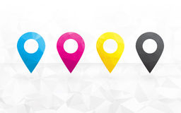 Cmyk colored pins. To determine the position on the map in the background triangular Royalty Free Stock Photos
