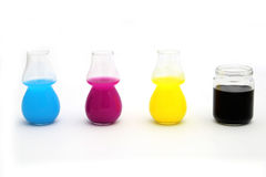 CMYK Concept. Colored ink in glass, cyano magenta yellow and black royalty free stock photo