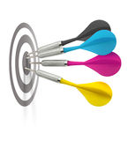 Cmyk darts hitting target Stock Photography