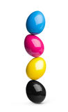 CMYK easter eggs pile. Easter eggs in cyan, magenta, yellow, black CMYK Stock Image