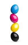 CMYK easter eggs pile. Easter eggs in cyan, magenta, yellow, black CMYK stock image
