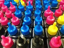 CMYK-färgpulverflaskor för skrivare Fotografering för Bildbyråer