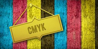 CMYK golden plate on wooden door Stock Photo