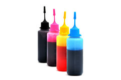 Cmyk ink. Color paints in bottles isolated on white stock photo