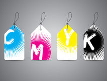 Cmyk labels with painted text in halftones Royalty Free Stock Photo
