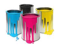 Cmyk paint tin cans. Metal tin cans with four process color cmyk paints flowing royalty free stock photo