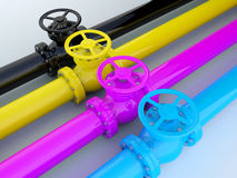CMYK pipelines. Industrial printing - CMYK pipelines with valves Stock Photography