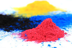 Cmyk toner powder (cyan, magenta, yellow, black) stock photography