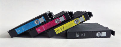 Cmyk toners. Four basic cmyk printer toners lying side by side. There is cyan, magenta, yellow and key or black Royalty Free Stock Images