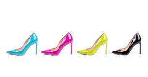 CMYK-uppsättning av skor för hög häl för färg isolerade kvinnliga Arkivbilder