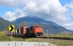 CN Goederentrein bij Dewdney-Spoor Kruising Stock Foto