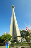 Cn toronto tower. Against blue sky and canadian flag close the ontario lake Royalty Free Stock Image