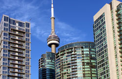 CN Tower and residential buildings against blue sky Stock Photos