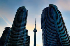 CN Tower Between Two Condominiums. CN Tower stuck Between Two new Condominiums during Sunset in Toronto,Canada royalty free stock images