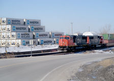 Landscape CN Train and shipping containers Royalty Free Stock Photography