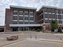 CNA Surety Building Main Entrance. CNA Surety building front doors behind the east bank of the Big Sioux River in downtown Sioux Falls, South Dakota Stock Photo