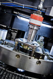 Cnc. Detail of cnc punching machine Royalty Free Stock Photo