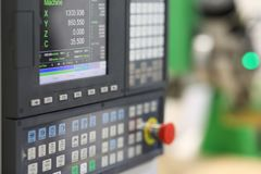 CNC control panel of lathe machine. Selective focus royalty free stock photography