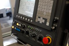 CNC control panel of metalworking machining center. Selective focus royalty free stock images