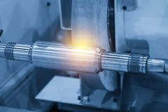 The CNC cylindrical grinding machine. With the steel shaft Stock Photography