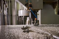 Cnc drilling machine close up. Metalworking machinery, steel shavings Royalty Free Stock Photos