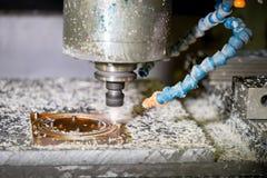 CNC drilling machine modern plant making plastic detail. CNC drilling machine in a modern plant making plastic detail stock photos