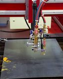CNC gas plasma cutting machine. Industrial metalwork royalty free stock image