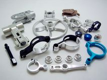 High precision aluminium automotive part manufacturing with CNC machine. royalty free stock images