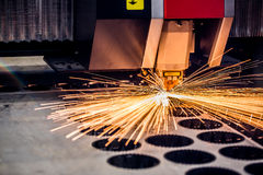 CNC Laser cutting of metal, modern industrial technology. Stock Photo