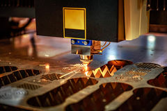 CNC Laser cutting of metal, modern industrial technology. . Royalty Free Stock Photo