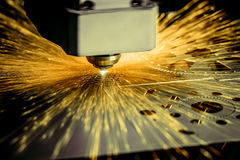 CNC Laser cutting of metal, modern industrial technology. . Stock Photos