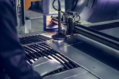 CNC laser plasma cutter. Modern metalworking technology at manufacturing plant or factory. Toned Royalty Free Stock Photo