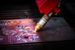 CNC Laser plasma cutting of metal, modern industrial technology. Stock Photos