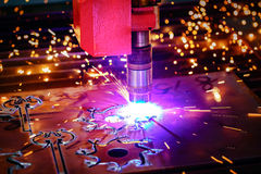 CNC Laser plasma cutting of metal, modern industrial technology. Royalty Free Stock Images