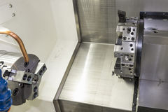 The CNC lath machine,close up to the head stock of CNC lath Royalty Free Stock Images
